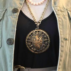 Extra-large lion amulet crest necklace.